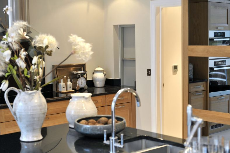A sleek, compact dumbwaiter food lift nestled within the kitchen of a modern, new-build private home