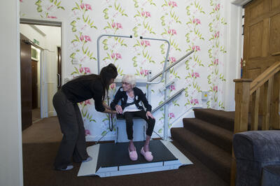 Stannah-folding-access-lift-care-home-in-use